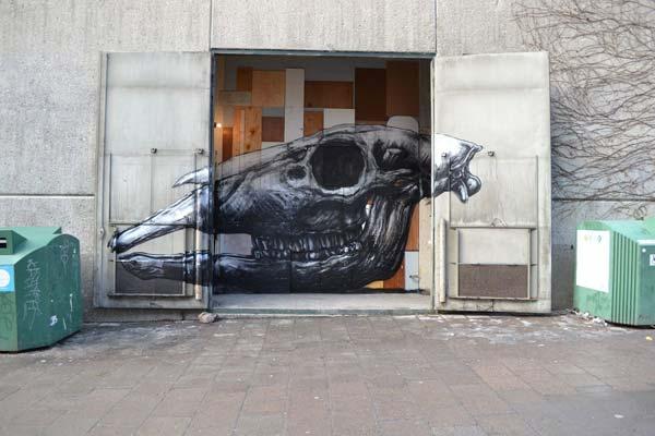 Urban art at a subway station in Stockholm, Sweden by Belgian artist ROA
