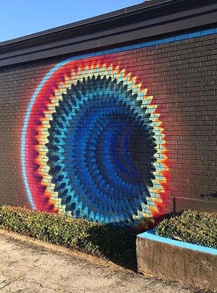 Street art mural in Texas by Hoxxoh
